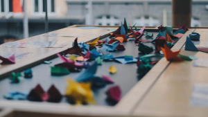 Instead of making the meeting room an archive for documents, maybe you could do some community origami once a week to ease the tension! Image Courtesy: Unsplash